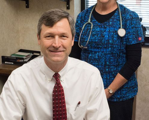 Dr. Andrews with his assistant, Joy Penland